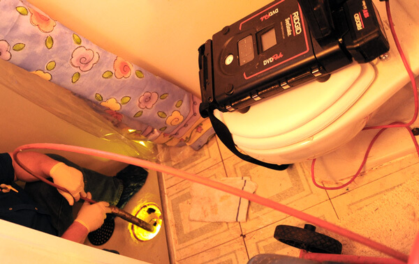 Active Plumbing cleaning shower drain rotorooter